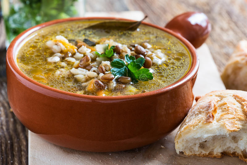 Homemade barley and lentil soup royalty free stock images
