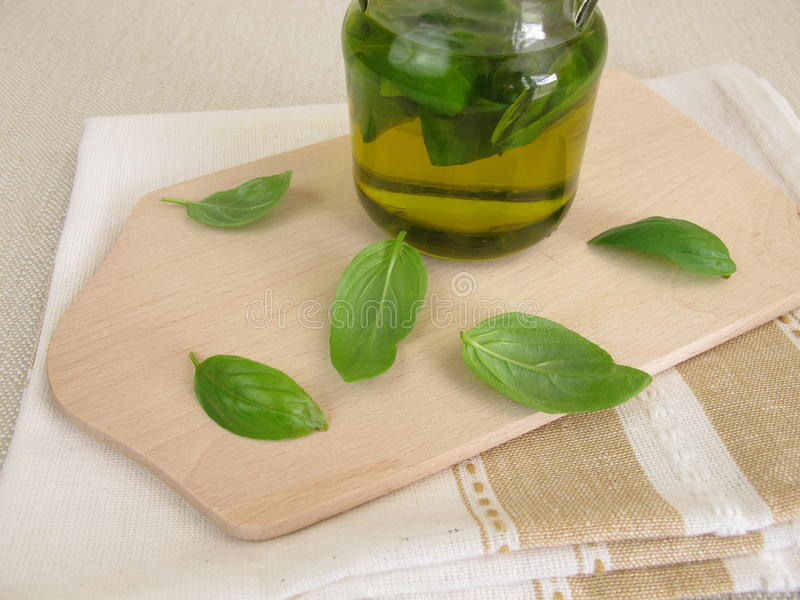 Homemade basil oil stock image