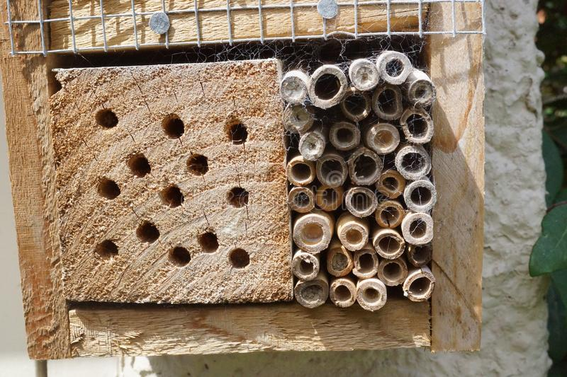 Homemade bee box. A home made bee box constructed to encourage solitary bees to live in it stock photo