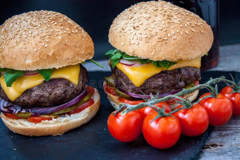 Homemade beef burgers royalty free stock photography