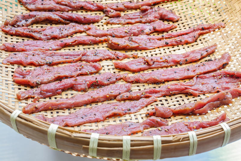 Homemade beef jerky on threshing basket stock photography