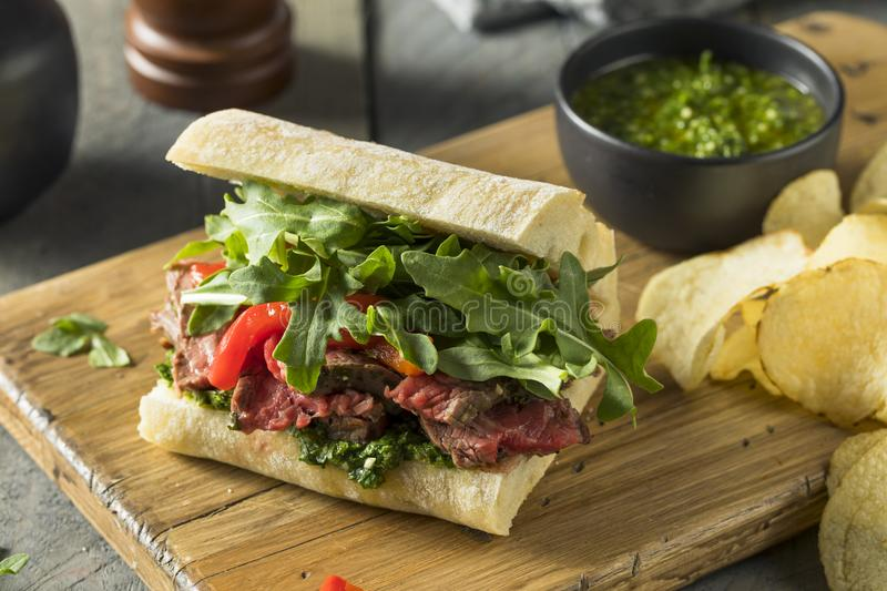 Homemade Beef Steak Sandwich. With Chimichurri and Arugula stock images