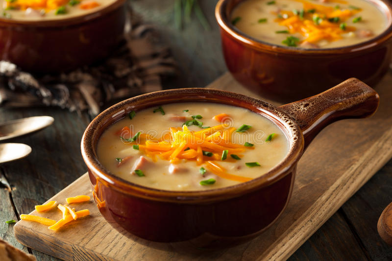 Homemade Beer Cheese Soup. With Chives and Bread royalty free stock images