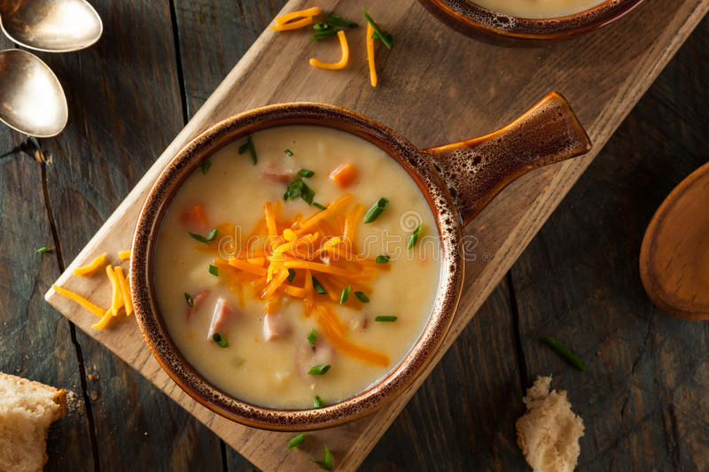 Homemade Beer Cheese Soup. With Chives and Bread stock image