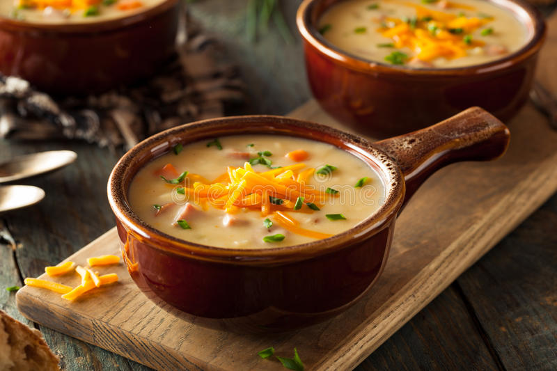 Homemade Beer Cheese Soup. With Chives and Bread stock images