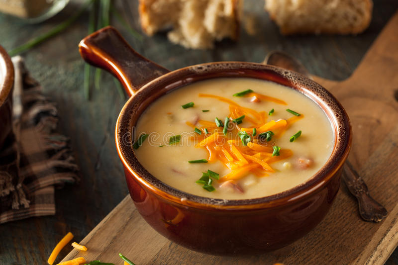 Homemade Beer Cheese Soup. With Chives and Bread royalty free stock image