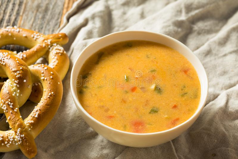 Homemade Beer Cheese Soup. With Soft Pretzels stock photography