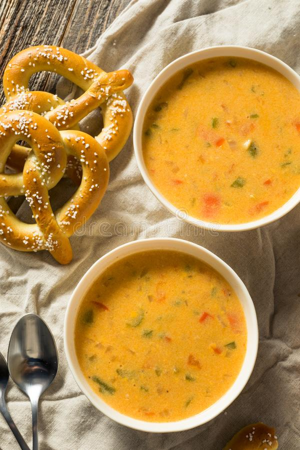 Homemade Beer Cheese Soup. With Soft Pretzels royalty free stock photography