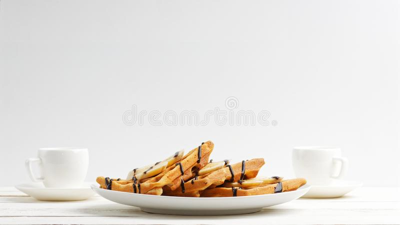 Homemade belgian waffles with banana slices topped stock photo