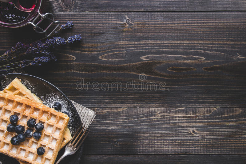 Homemade belgian waffles with blueberries on the dark wooden tab stock photos
