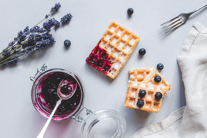 Homemade belgian waffles with blueberries and jam on the light b stock photo