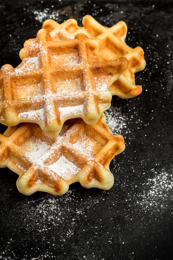Homemade belgian waffles with sugar powder stock image
