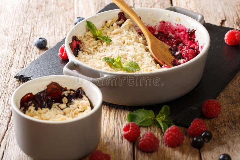 Homemade berry crumble with currant berries, raspberries and blu stock images