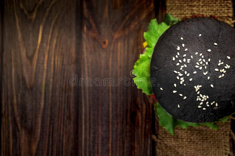 Homemade Black Burger with Cheese. Cheeseburger with black bun o stock photography