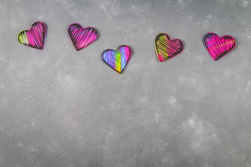 Homemade Black violet pink hearts on a gray concrete background. The concept of Valentine's Day. A symbol of love. stock photo