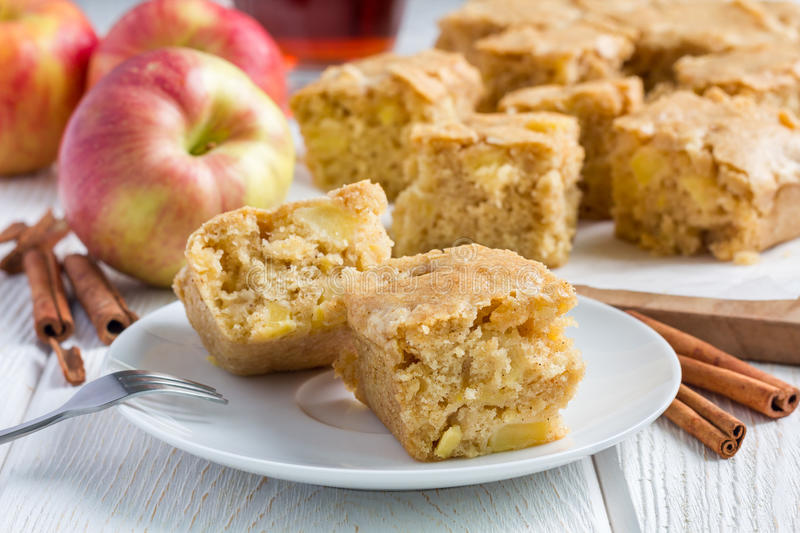 Homemade blondie (blonde) brownies apple cake, square slices on plate stock image