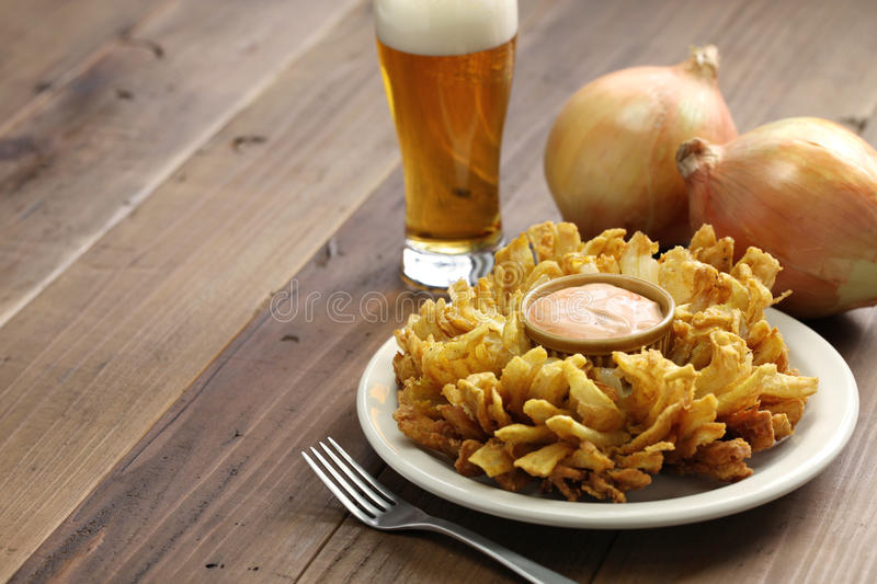 Homemade blooming onion and beer royalty free stock image