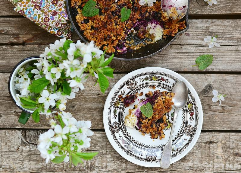 Homemade blueberry crumble on wooden table royalty free stock photo