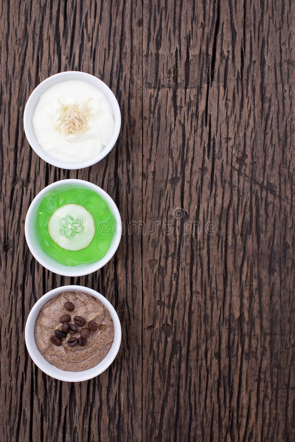 Homemade body scrubs on wood background. stock images