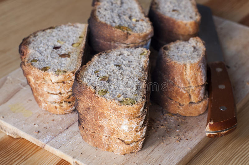 Homemade bread sliced. Delicious homemade bread sliced on a table royalty free stock photography