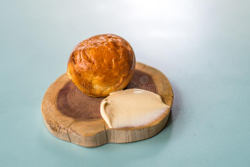 Homemade bread and unsalted butter appetiser. Homemade bread bun and unsalted butter appetiser in a restaurant royalty free stock photo