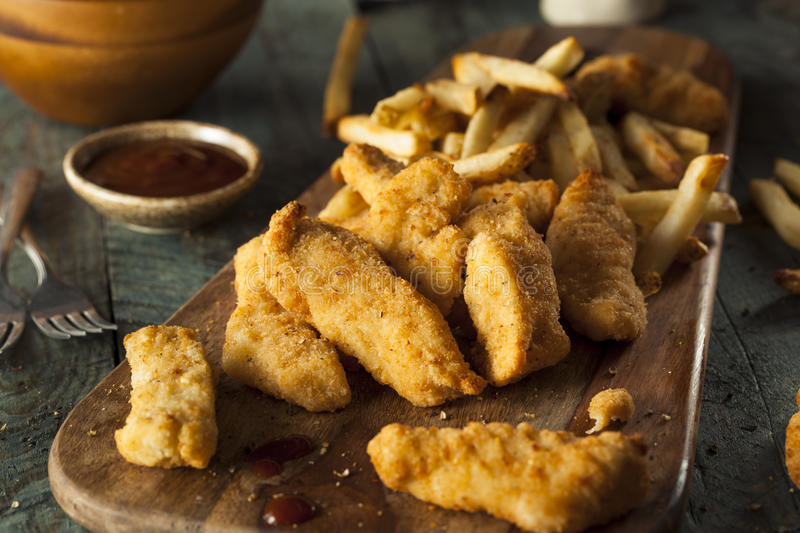 Homemade Breaded Chicken Tenders. With Fries and BBQ Sauce royalty free stock photos