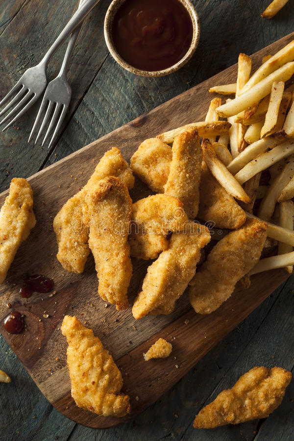 Homemade Breaded Chicken Tenders. With Fries and BBQ Sauce royalty free stock images