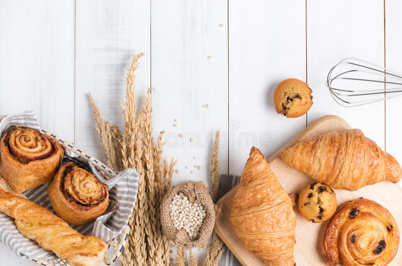Homemade breads or bun on wood background. Croissant puff cinnamon, breakfast food royalty free stock photo