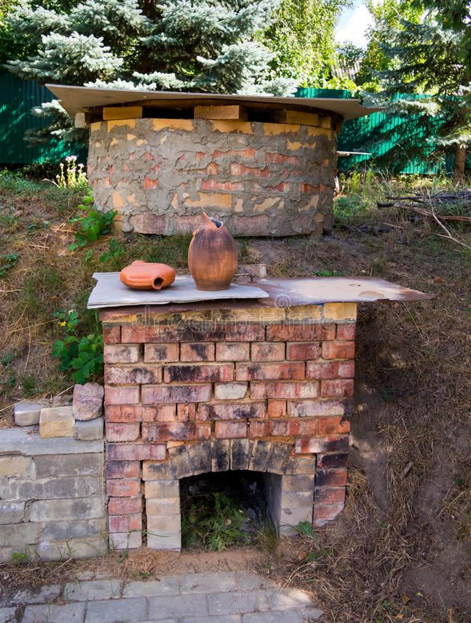 Homemade brick oven for burning pottery in the yard.  stock photo
