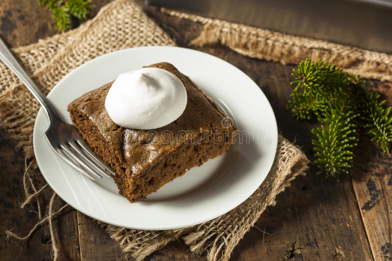 Homemade Brown Gingerbread Cake. With Whipped Cream royalty free stock photo
