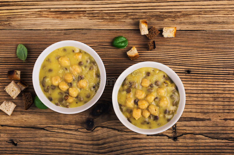 Homemade brown lentil soup with chickpeas royalty free stock images