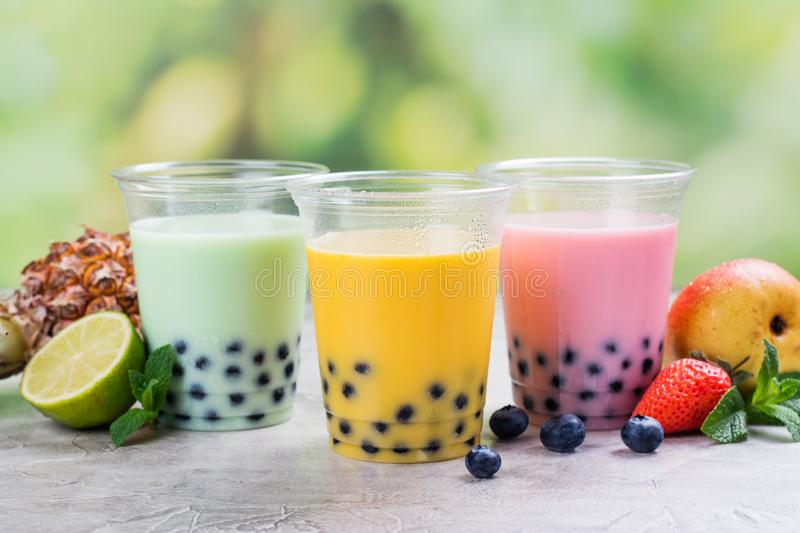Homemade bubble tea with tapioca pearls. Variety of homemade bubble tea with tapioca pearls. Lime, mango, raspberry bubble teas with fruits and berries on summer stock image