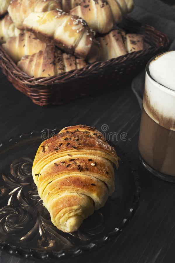 Homemade Buns and coffee on wooden table. Close up stock image