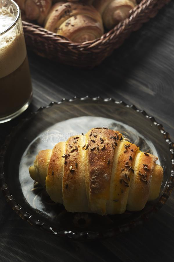 Homemade Buns and coffee on wooden table. Close up royalty free stock photography
