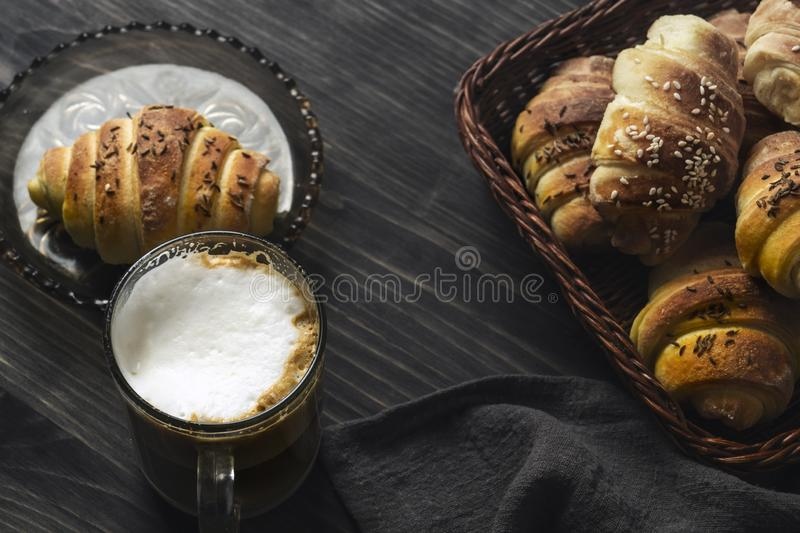 Homemade Buns and coffee on wooden table. Close up stock images