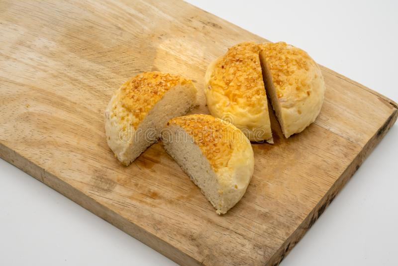 Homemade buns with sesame seeds on wooden square cutting board i royalty free stock photography
