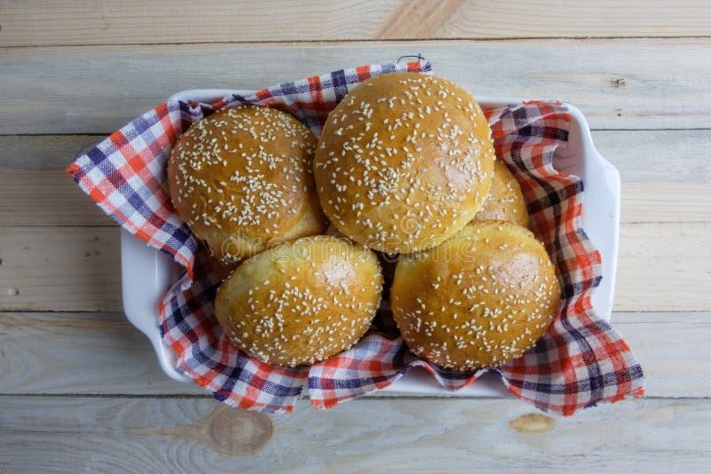 Homemade burger bun on plate royalty free stock photos