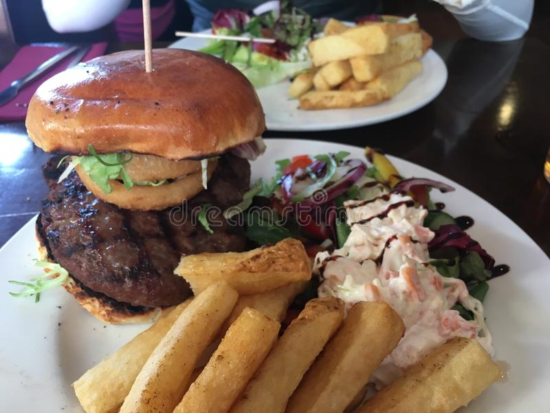 Homemade Burger With Chips, Coleslaw & Salad stock photography