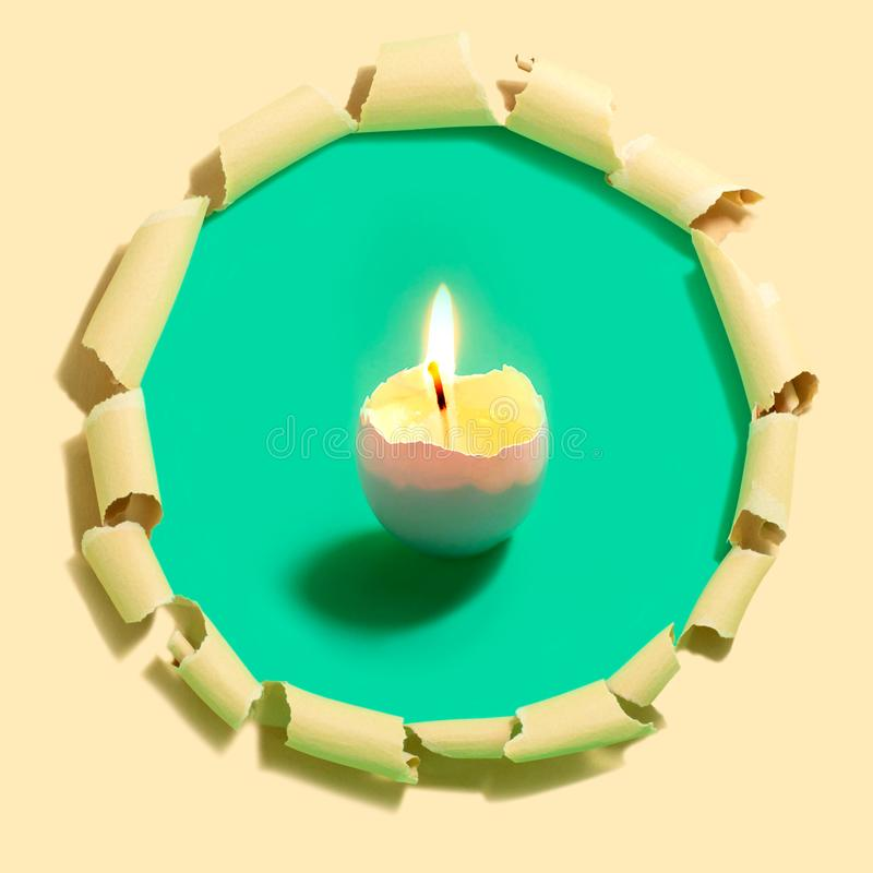 Homemade burning candle in eggshell royalty free stock images