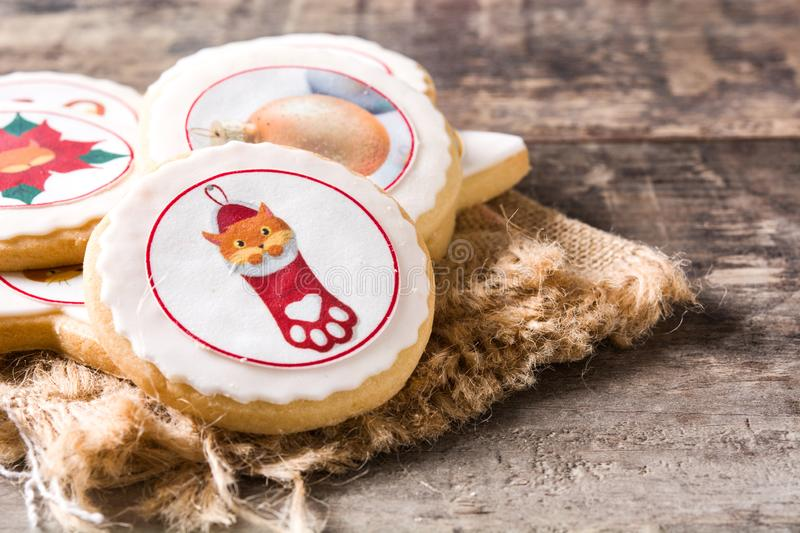 Homemade butter cookies with a printed Christmas cat design. Homemade Christmas butter cookies with a printed Christmas cat design on wooden table. Copyspace stock photo