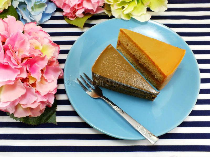 Homemade cake on dish with spring flower and space copy background. Top view of cake on dish with spring flower and space copy background royalty free stock photography