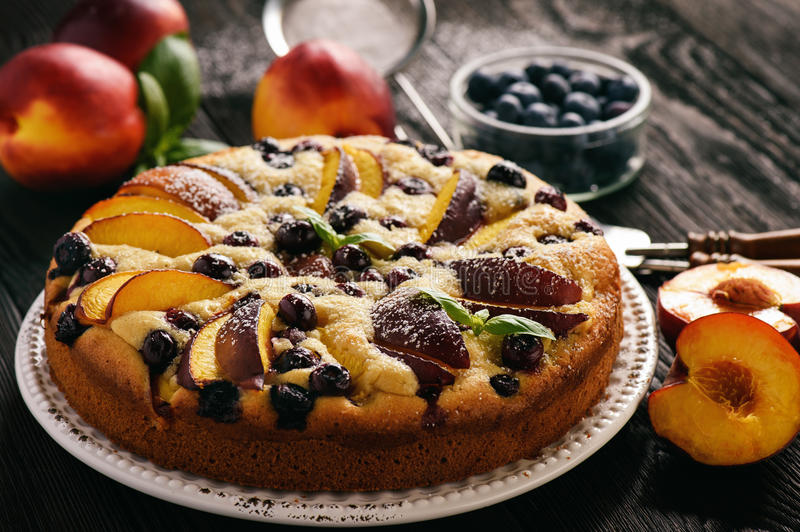 Homemade cake with nectarines and blueberries. Homemade cake with nectarines and blueberries royalty free stock images