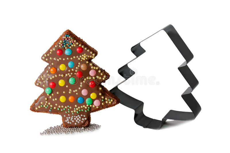 Homemade cake in shape of christmas tree and form for baking stock photography