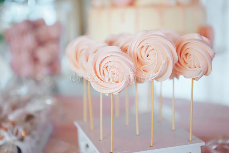 Homemade candies meringue on stick Meringue candy on wooden stick. Festive sweet table for children. Candy Bar royalty free stock photography