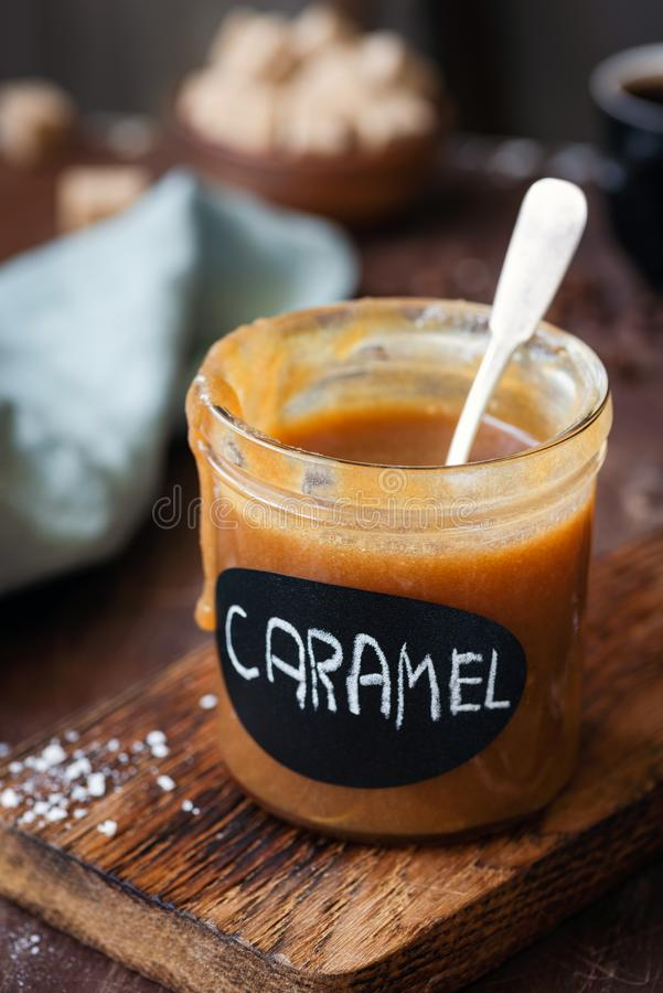Homemade caramel sauce in a jar royalty free stock images