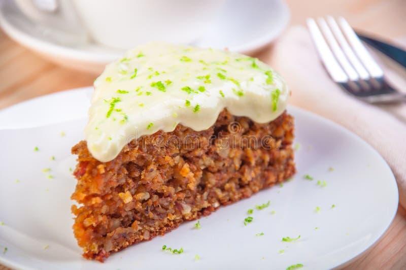Homemade carrot cake dessert on the white plate stock photography