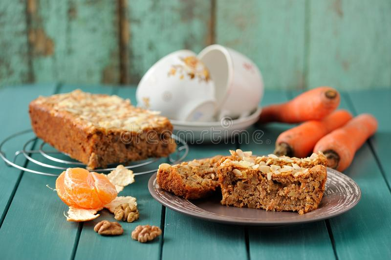 Download Homemade Carrot Cake With Fresh Carrots And Clementines On Turqu Stock Image - Image: 83712063