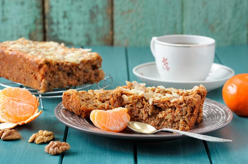 Download Homemade Carrot Cake With Fresh Clementines On Turquoise Backgro Stock Image - Image: 83712301