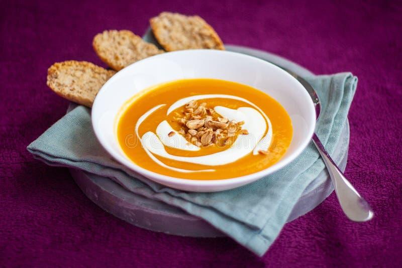 Homemade carrot and sweet potato cream soup stock photo