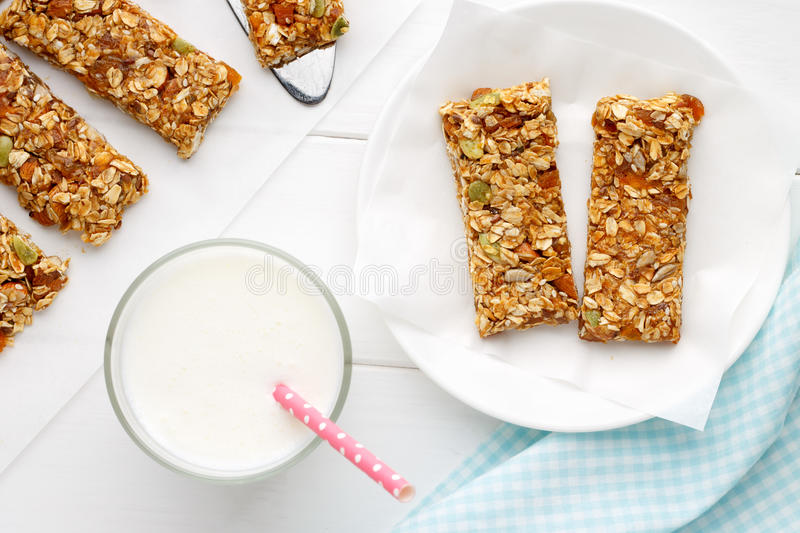 Homemade cereal snacks for healthy eating granola bars with milk on download homemade cereal snacks for healthy eating granola bars with milk on white wooden background ccuart Choice Image